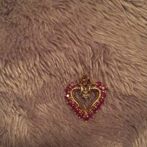 Ruby and diamond heart pendant in 10kt gold